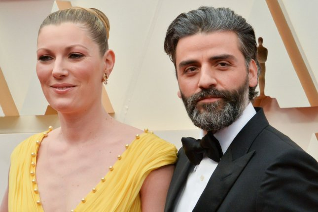 Oscar Isaac (R) and his wife Elvira Lind arrive for the 92nd annual Academy Awards on February 2020. Isaac will be taking on the lead role in Sony's Metal Gear Solid film. File Photo by Jim Ruymen/UPI