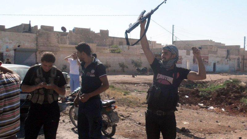 Members of the Free Syrian Army chant slogans against Syrian President Bashar al-Assad in Aleppo on July 19. UPI/Khaled Tallawy
