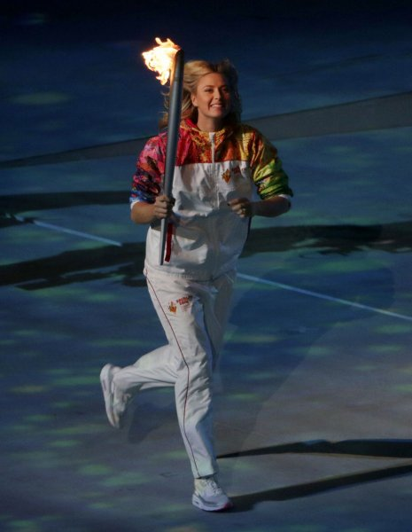 Maria Sharapova carries the Olympic torch into the stadium during the Opening Ceremony for the Sochi 2014 Winter Olympics on February 7, 2014 in Sochi, Russia. The opening ceremony marks the opening of the Sochi 2014 Olympics. UPI/Molly Riley