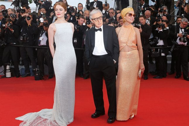 Emma Stone (L), Woody Allen (C) and Parker Posey arrive at the screening of Irrational Man during the 68th annual Cannes International Film Festival in France on May 15, 2015. Photo by David Silpa/UPI