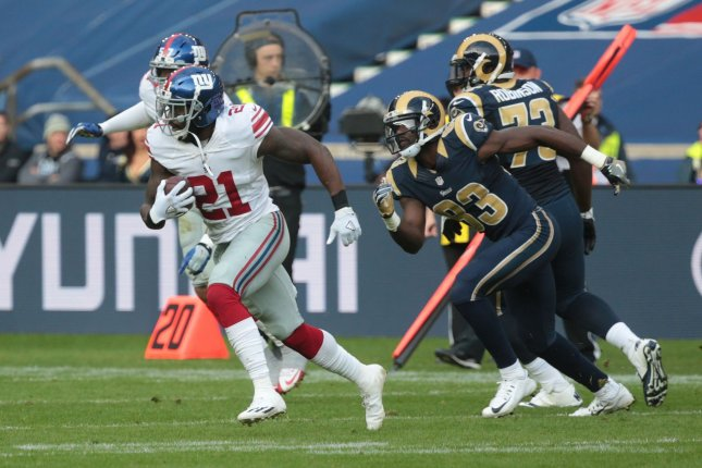 New York Giants Strong Safety Landon Collins runs with the ball for a touchdown in their match against the Los Angeles Rams at Twickenham Stadium, London on October 23, 2016. Photo by Hugo Philpott/UPI.