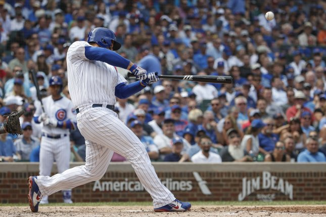 Chicago Cubs first baseman Anthony Rizzo hits an RBI single against the Milwaukee Brewers in the fourth inning on August 15 at Wrigley Field in Chicago. Photo by Kamil Krzaczynski/UPI