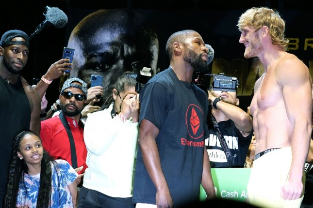 Floyd Mayweather and Logan Paul face off after attending the official weigh-in Saturday for their exhibition fight Sunday at the Hard Rock Live at Seminole Hard Rock Hotel and Casino in Hollywood, Fla. Mayweather weighed in at 155 pounds and Paul at 189.5. Photo by Gary I Rothstein/UPI