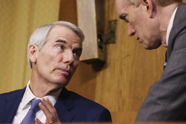 Sen. Rob Portman, R-Ohio, speaks with Sen. James Lankford, R-Okla., during a Senate Finance Committee hearing on June 8. Portman and moderate Republicans and Democrats Wednesday reach a deal on a bipartisan infrastructure package. Photo by Evelyn Hockstein/UPI