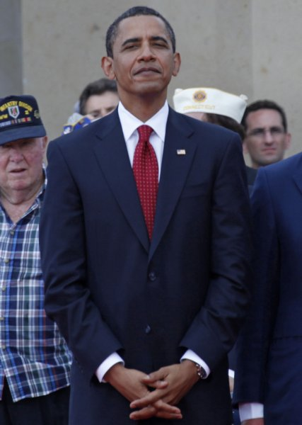 U.S. President Barack Obama rises after a speech by British Prime Minister Gordon Brown at the Normandy American Cemetery in Colleville-sur-Mer during a ceremony commemorating the 65th anniversary of the D-Day landings in the Normandy region of France on June 6, 2009. (UPI Photo/ David Silpa)