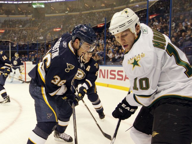 Dallas Stars Brenden Morrow (10) and St. Louis Blues Matt D'Agostini battle in the corner in the first period at the Scottrade Center in St. Louis, Nov. 27, 2010. UPI/Bill Greenblatt