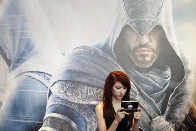 An attendee plays an electronic game during E3, the Electronic Entertainment Expo held at the LA Convention Center in Los Angeles on June 9, 2011. UPI/Phil McCarten