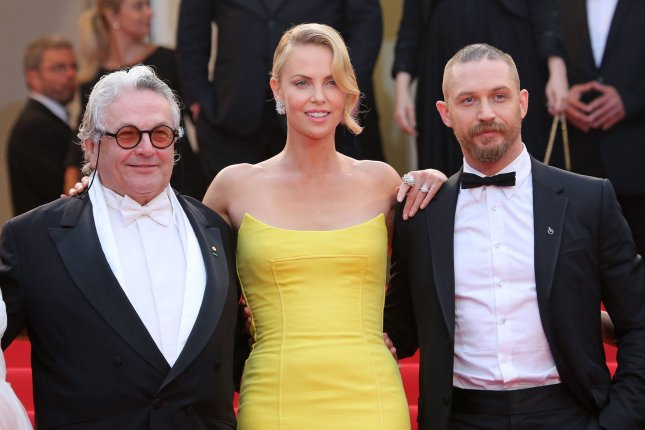 George Miller (L) with 'Mad Max: Fury Road' stars Charlize Theron and Tom Hardy (R) at the film's Cannes International Film Festival screening on May 14, 2015. The director says he has two sequels in the works. File Photo by David Silpa/UPI