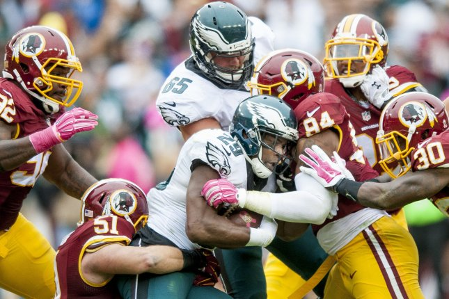 Philadelphia Eagles' running back DeMarco Murray is stopped by the Redskins' defense during the fourth quarter against the Washington Redskins at FedExField on October 4, 2015 in Landover, Maryland. The Redskins won the game 23-20. Photo by Pete Marovich/UPI