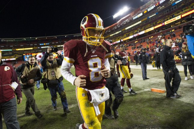 Washington Redskins quarterback Kirk Cousins (8) leaves the field after they lost to the Green Bay Packers 35-18 in their NFC Wild Card game at FedEx Field in Landover, Maryland on January 10, 2015. Photo by Kevin Dietsch/UPI