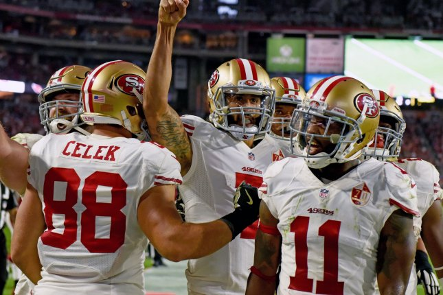 San Francisco's quarterback Colin Kaepernick raises his fist after scoring the game-tying touchdown in the fourth quarter of the 49ers-Arizona Cardinals game on Nov. 13. File Photo by Art Foxall/UPI