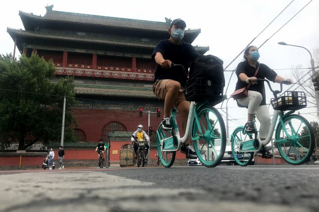 Bicyclists ride through a historic area of Beijing, China, on June 30. Wednesday's study said populous nations like China and India are expected to see sharp declines in their working-age populations by the turn of the next century. Photo by Stephen Shaver/UPI