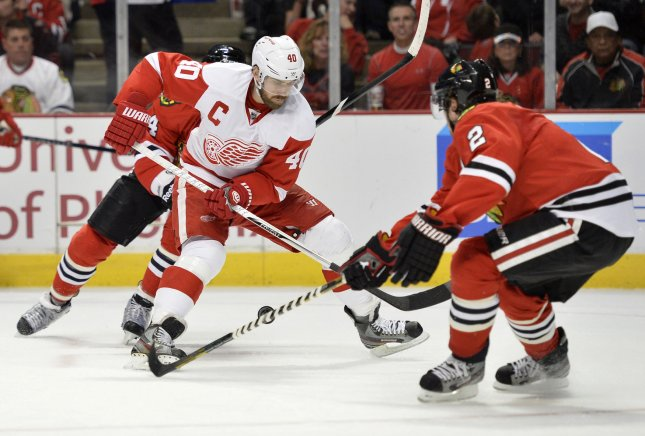 Detroit Red Wings center Henrik Zetterberg (C), shown in a game last April will miss at least eight weeks of play after undergoing back surgery, the team said Friday. UPI/Brian Kersey
