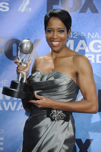 Regina King poses backstage with her award at the 42nd NAACP Image Awards Awards held at the Shrine Auditorium in Los Angeles on March 4, 2011. UPI/Phil McCarten