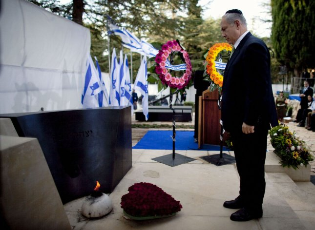 Israeli Prime Minister Benjamin Netanyahu stands by the grave of Israeli Prime Minister Yitzhak Rabin during a memorial ceremony marking the 14th anniversary of his assassination on October 29, 2009 in Jerusalem, Israel. Rabin was shot and killed by right-wing Jewish activist Yigal Amir on November 4, 1995. UPI/Uriel Sinai/Pool