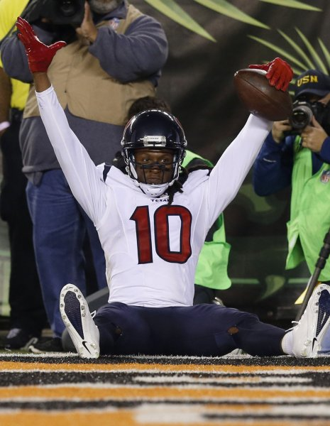 Houston Texans receiver DeAndre Hopkins celebrates a touchdown catch in a game against the Cincinnati Bengals. Photo by John Sommers II/UPI