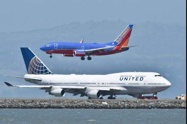 A Southwest Airlines flight lands at San Francisco International Airport in San Francisco, Calif. The carrier will begin service from California to Hawaii March 17. File Photo by Terry Schmitt/UPI