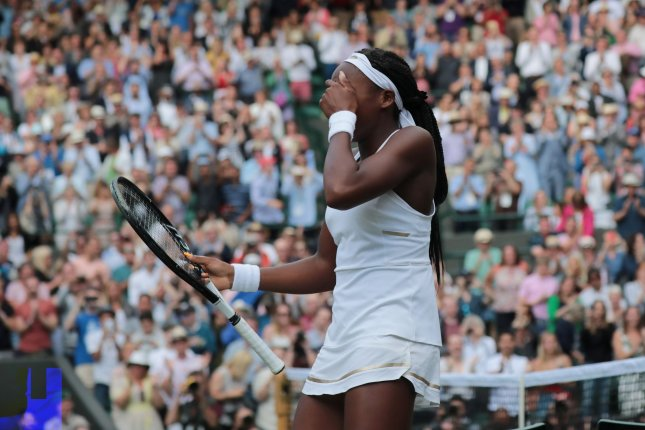 Cori Gauff defeats Venus Williams in the first round at Wimbledon on Monday. Gauff beat Williams 6-4, 6-4. Photo by Hugo Philpott/UPI
