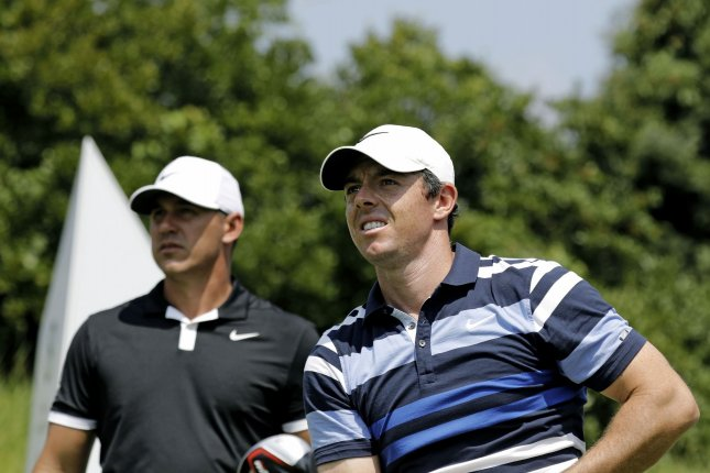 Brooks Koepka (L), Rory McIlroy (R) and Jon Rahm will be a featured group for the first and second rounds of the 2020 Charles Schwab Challenge on Thursday and Friday at Colonial Country Club in Fort Worth, Texas. File Photo by Peter Foley/UPI