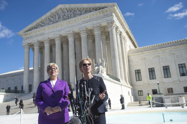 Supreme Court set precedent striking down a Texas abortion law in 2016 that led to a 5-4 ruling Monday against a similar Louisiana law. Lead plaintiff Amy Hagstrom Miller (L), CEO of Whole Woman's Health, and Nancy Northup, CEO of Center for Reproductive Rights, are seen outside the Supreme Court after arguments in 2016 case. File Photo by Kevin Dietsch/UPI