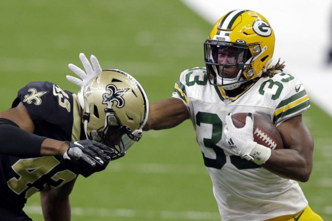 Green Bay Packers running back Aaron Jones (33) has a great Week 14 matchup and should help you win the first game of the fantasy football playoffs. File Photo by AJ Sisco/UPI