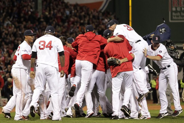 The Boston Red Sox celebrate after becoming the American League Champions after defeating the Detroit Tigers 5-2 at Fenway Park in Boston on October 19, 2013. The Red Sox will face the St. Louis Cardinals in the World Series. UPI/Matthew Healey