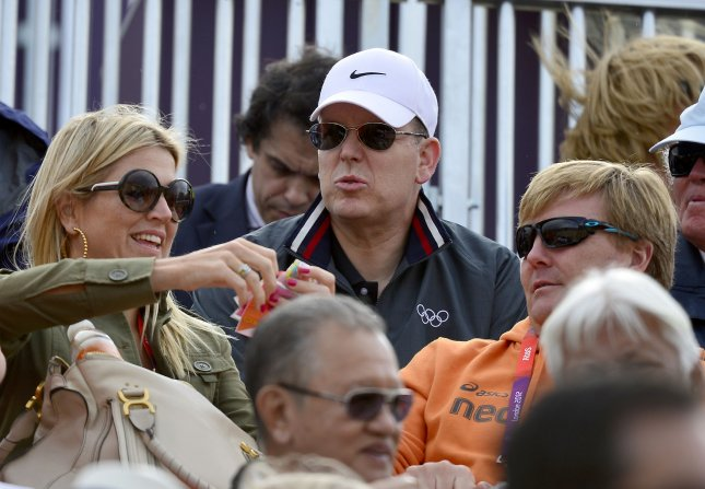 Prince Albert of Monaco, center, and The Netherlands' Crown Prince Willem Alexander, right, and Crown Princess Maxima, left, during the Equestrian Individual Jumping round 2 competition at the London 2012 Summer Olympics on August 5, 2012 in London. UPI/Ron Sachs