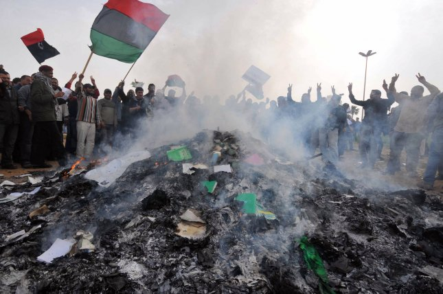 Libyans burn books authored by Libyan leader Moammar Gadhafi at a local park of the Benghazi, Libya on March 2, 2011. Gadhafi warned the West against intervening in the rebellion against his rule. UPI/Mohamaad Hosam