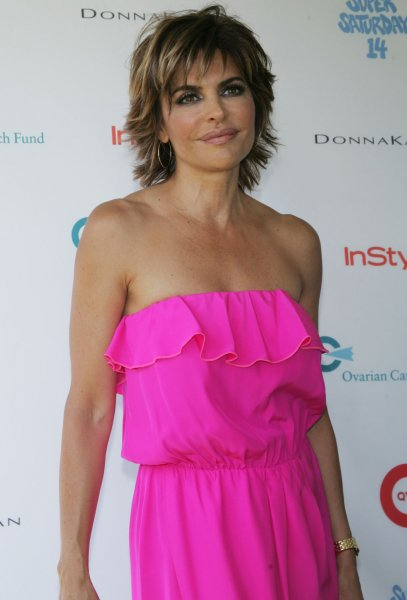 Lisa Rinna arrives for the Super Saturday 14 in Water Mill, New York on July 30, 2011. UPI /Laura Cavanaugh