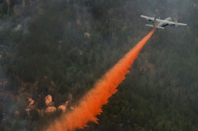 A C-130 Hercules aircraft drops fire suppressant on the Waldo Canyon wildfire in Colorado Springs, CO on June 27, 2012. UPI/Stephany D. Richards/US Air Firce