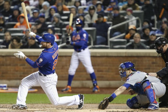 New York Mets Daniel Murphy hits a 2-run home run in the first inning in game two of the NLCS against the Chicago Cubs at Citi Field in New York City on October 18, 2015. Photo by John Angelillo/UPI