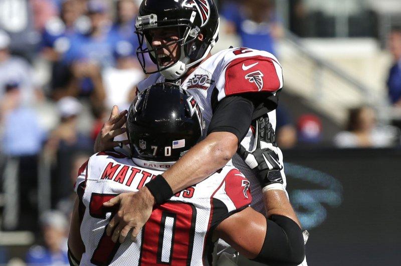 Atlanta Falcons quarterback Matt Ryan and Jake Matthews celebrate a touchdown. Photo by John Angelillo/UPI