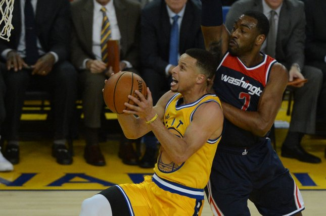 Golden State Warriors Stephen Curry (L) puts up a shot in front of Washington Wizards John Wall (2). File photo by Terry Schmitt/UPI