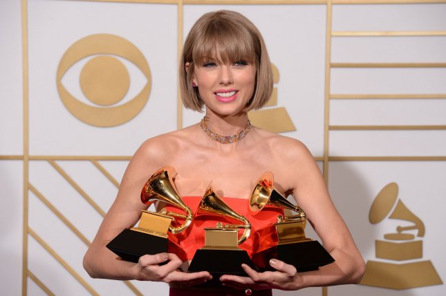 Taylor Swift appears backstage during the 58th annual Grammy Awards on February 15, 2016. Swift will be performing on select dates as part of the Jingle Ball Tour alongside Ed Sheeran and Demi Lovato. File Photo by Phil McCarten/UPI