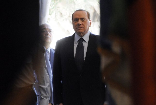 Former Italian Prime Minister Silvio Berlusconi arrives for a welcoming ceremony at the office of Israeli Prime Minister Benjamin Netanyahu in Jerusalem, February 1, 2010. n Monday, Berlusconi said his party would deport 600,000 immigrants if they regain power after next month's elections. File Photo by Debbie Hill/UPI