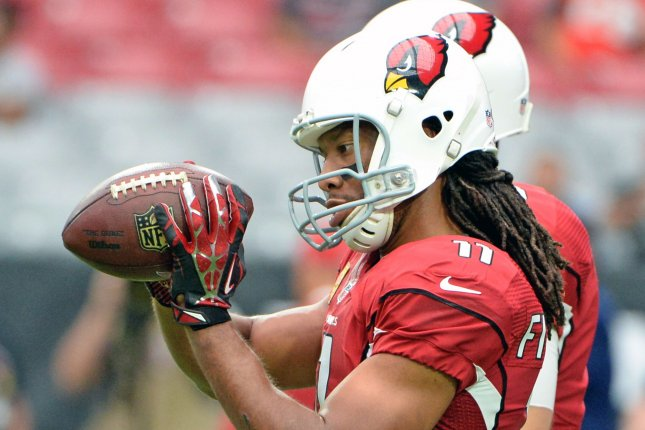 Arizona Cardinals star wide receiver Larry Fitzgerald looks at the ball after catching a pass as he warms up for the Cardinals-Tampa Bay Buccaneers game on September 18, 2016 at University of Phoenix Stadium in Glendale, Arizona. File photo by Art Foxall/UPI