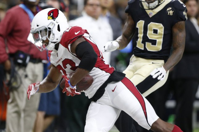 Arizona Cardinals defensive back Bene Benwikere (23) intercepts a pass intended for New Orleans Saints wide receiver Ted Ginn Jr. (19) in the second quarter on August 17, 2018 at the Mercedes-Benz Superdome in New Orleans. Photo by AJ Sisco/UPI