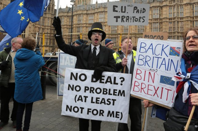 Brexit protestors campaign outside Houses of Parliament whilst the Members of Parliament prepare to vote on this evening's vital Brexit vote on Tuesday. Photo by Hugo Philpott/UPI