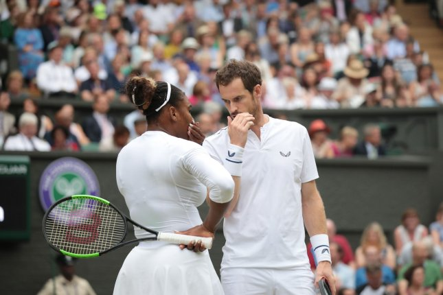 Andy Murray played mixed doubles with Serena Williams in July at Wimbledon in London. File Photo by Hugo Philpott/UPI