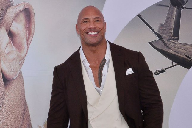 Dwayne Johnson will be a special guest on Oprah Winfrey's Weight Waters tour along with Lady Gaga and Michelle Obama. File Photo by Jim Ruymen/UPI