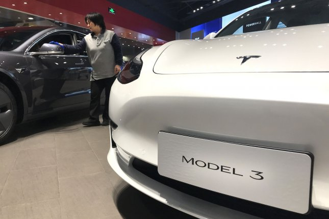 A Tesla Model 3 sedan is seen in the automaker's flagship showroom in Beijing, China, on January5. The automaker said the total amount raised could exceed $2.3 billion. File Photo by Stephen Shaver/UPI
