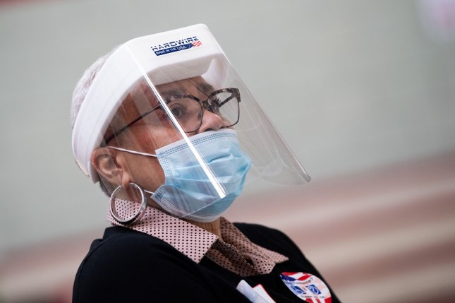 A poll worker wears protective equipment during the special election for Maryland's 7th Congressional District to choose a successor to the late Rep. Elijah Cummings during the COVID-19 pandemic in Baltimore City, Md., on Tuesday. Photo by Kevin Dietsch/UPI