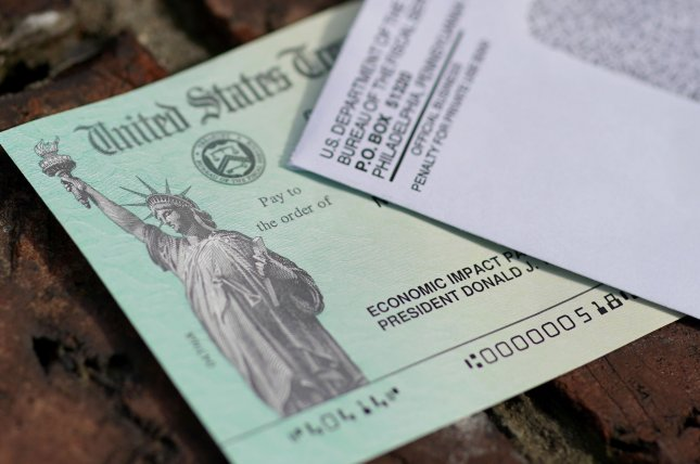 Without new legislation, Americans who are subject to garnishment would likely never see their $1,400 stimulus payment from the IRS. By law, banks are required to turn it over to debt collectors. File Photo by John Angelillo/UPI
