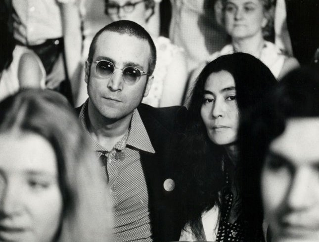 John Lennon and his wife Yoko Ono listen in on the Watergate hearings on Capitol Hill in this 1973 UPI file photo.
