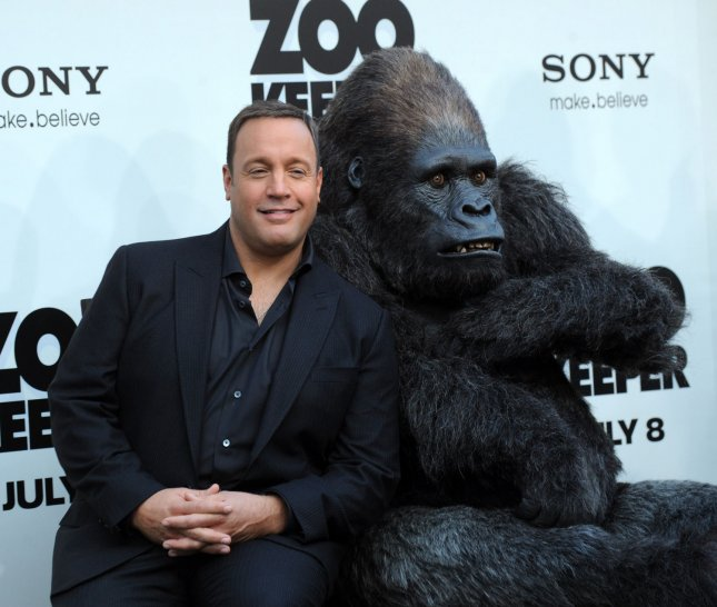 Kevin James, producer, writer and star of the motion picture romantic comedy Zookeeper, poses alongside an actor in a gorilla costume at the premiere of the film in Los Angeles on July 6, 2011. UPI/Jim Ruymen