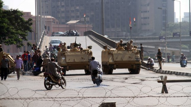 Egyptian Army armored vehicles at a checkpoint in Cairo, Egypt amid bloody clashes between the military-backed government and supporters of ousted Islamist president Mohammed Morsi. (File/UPI/Ahmed Jomaa)