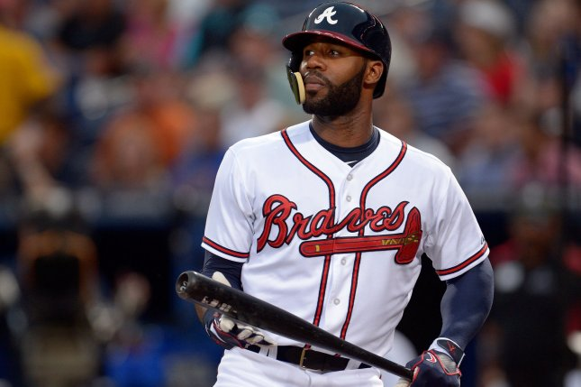 Atlanta Braves right fielder Jason Heyward wears a protective helmet as he takes the batter's box in the first inning at Turner Field in Atlanta, September 23, 2013. Heyward broke his jaw in two places in a game against the New York Mets earlier this season. UPI/David Tulis
