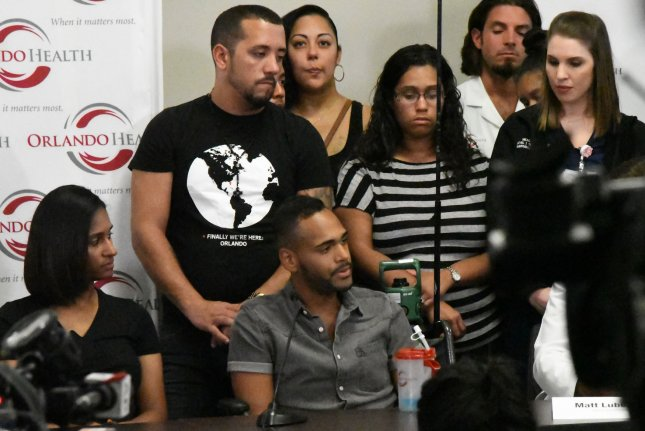 Angel Colon, one of the 53 survivors from the Pulse nightclub tragedy talks to the media surrounded by friends and family at the Orlando Regional Medical Center in Orlando, Fla., on Tuesday. Photo by Gary I Rothstein/UPI..
