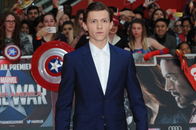 Tom Holland attends the U.K. premiere of Captain America: Civil War on April 26, 2016. Holland stars in the third trailer for Spider-Man: Homecoming alongside Robert Downey Jr. as Iron Man. File Photo by Paul Treadway/ UPI