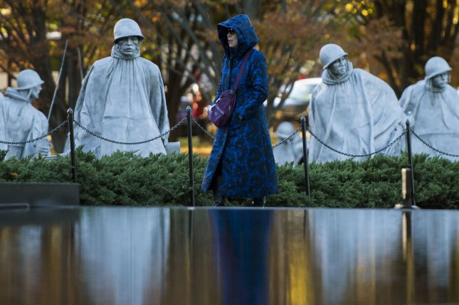 A woman visits the Korean War Memorial on Friday in Washington, D.C. Photo by Kevin Dietsch/UPI